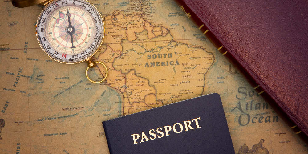 Passport and compass on the map