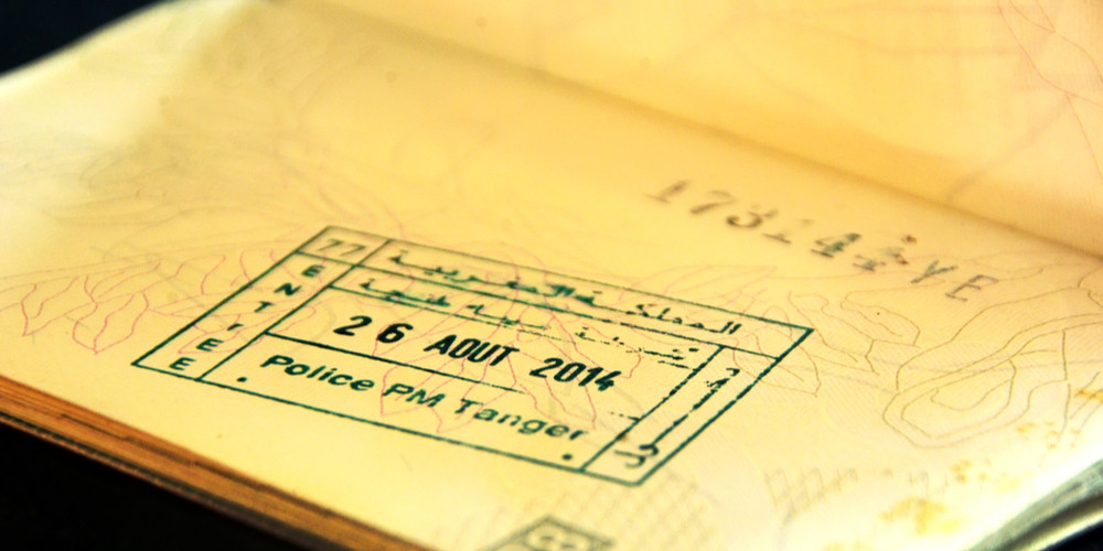 Visa entry stamps in passport